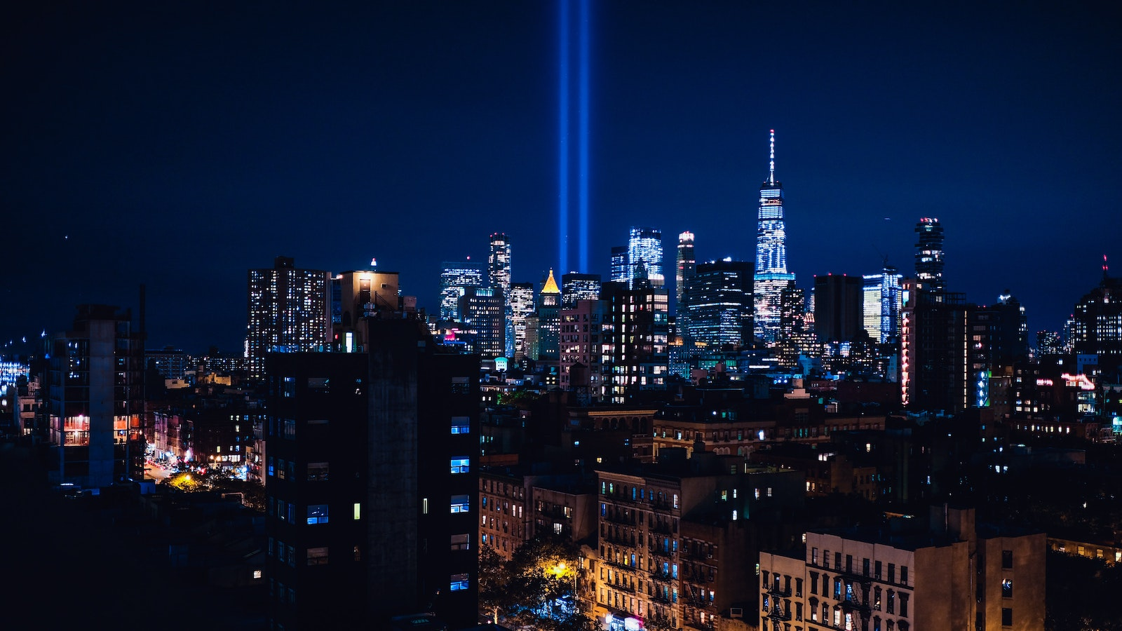 Two beams of light in nighttime sky commemorate the 9/11 attacks