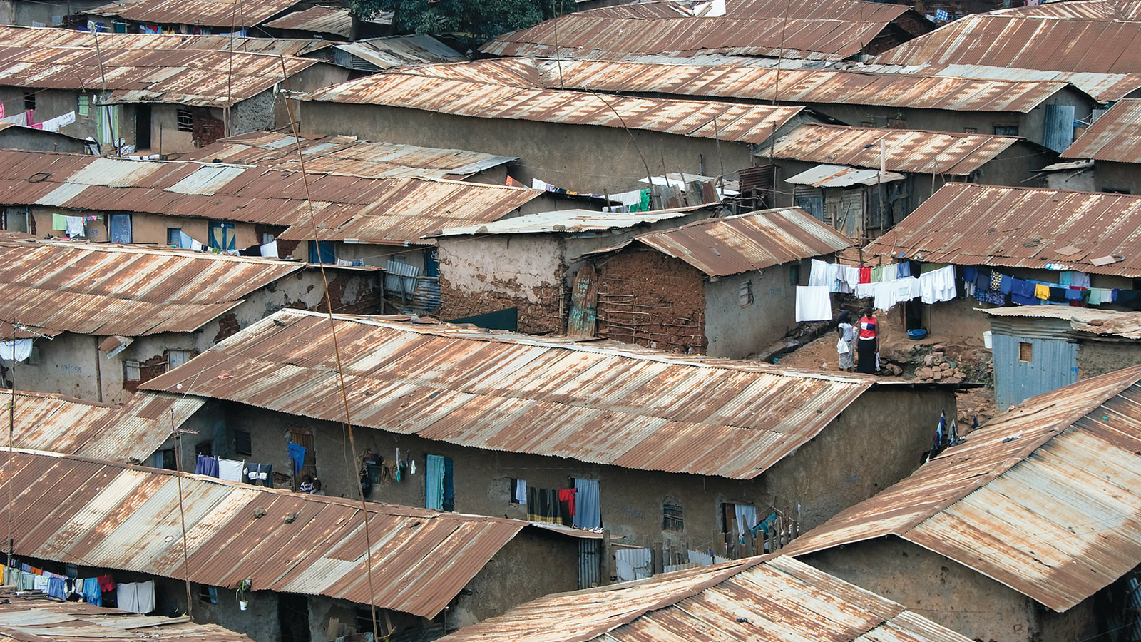 Shantytown with Tin Roofs and Laundry Outside
