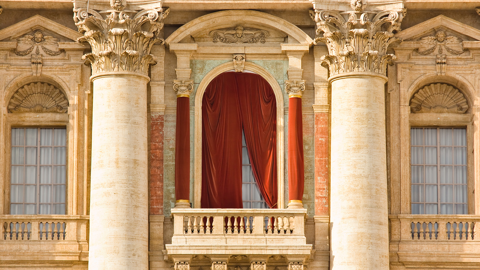 St. Peter's Basilica window where the Pope addresses the faithful.