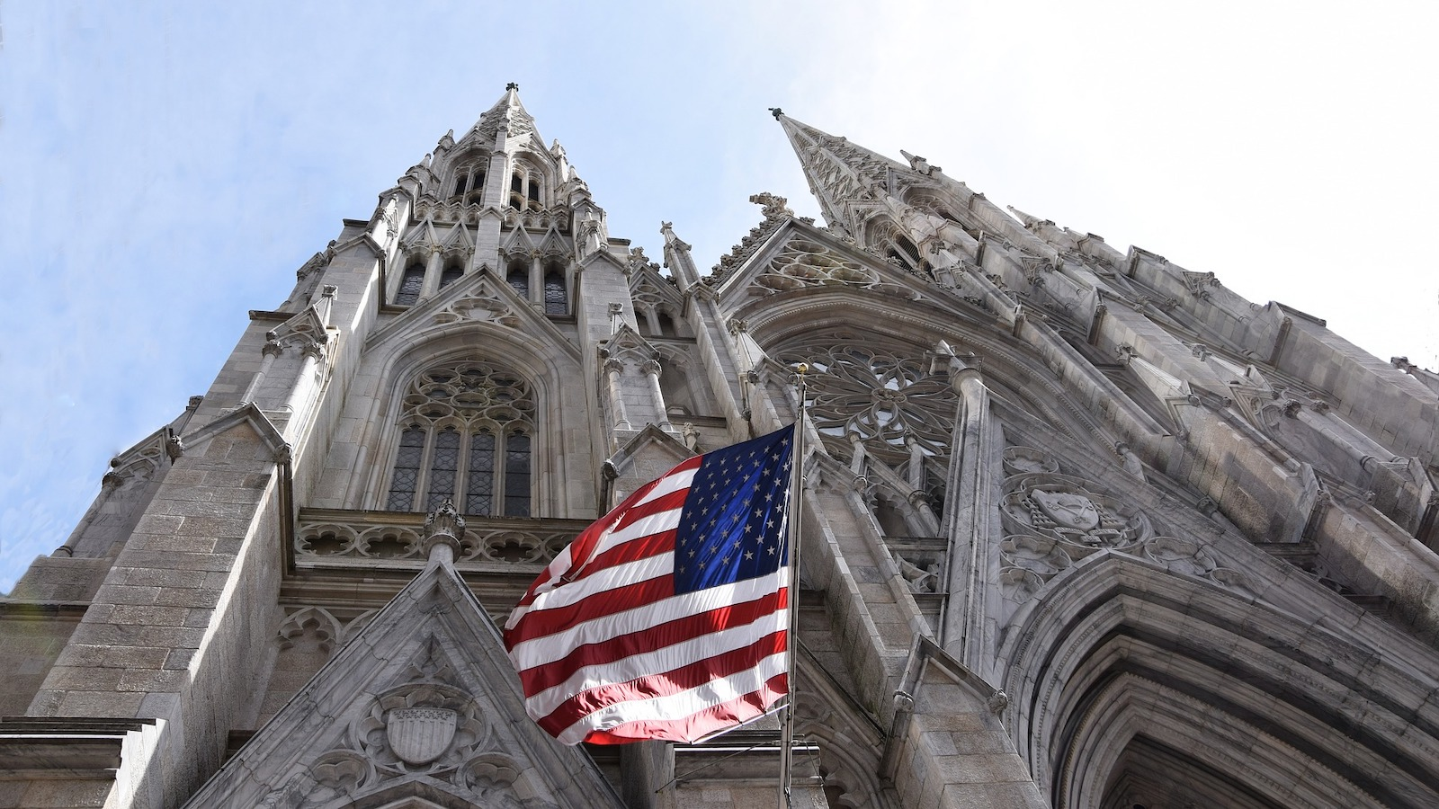 U.S. flag flies in front of St. Patrick's Cathedral in New York City