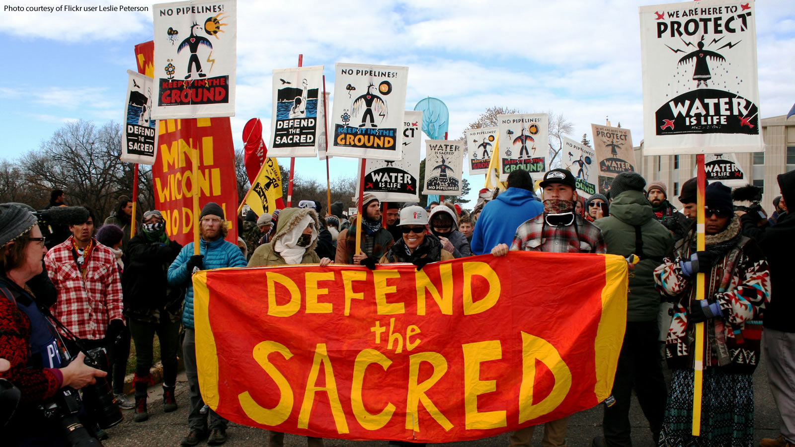 Standing Rock Protestors with Defend Sacred Water Banners