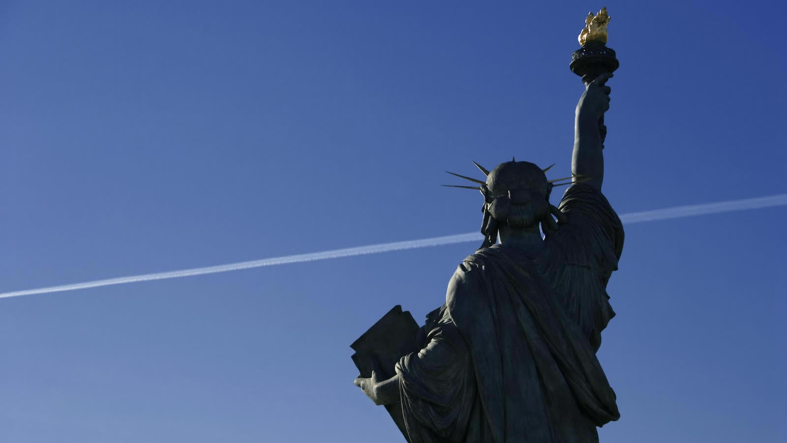 Statue of Liberty with Plane Contrail