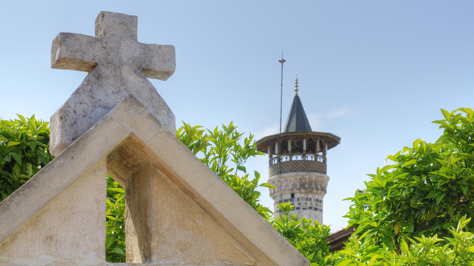 Stone Cross and Mosque Minaret
