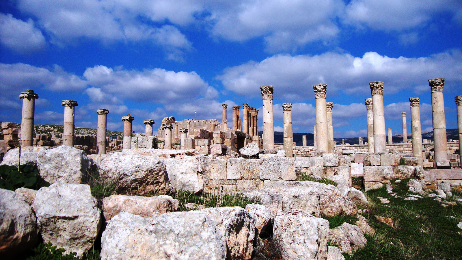 Stone Ruins with Greek Columns and Clouds