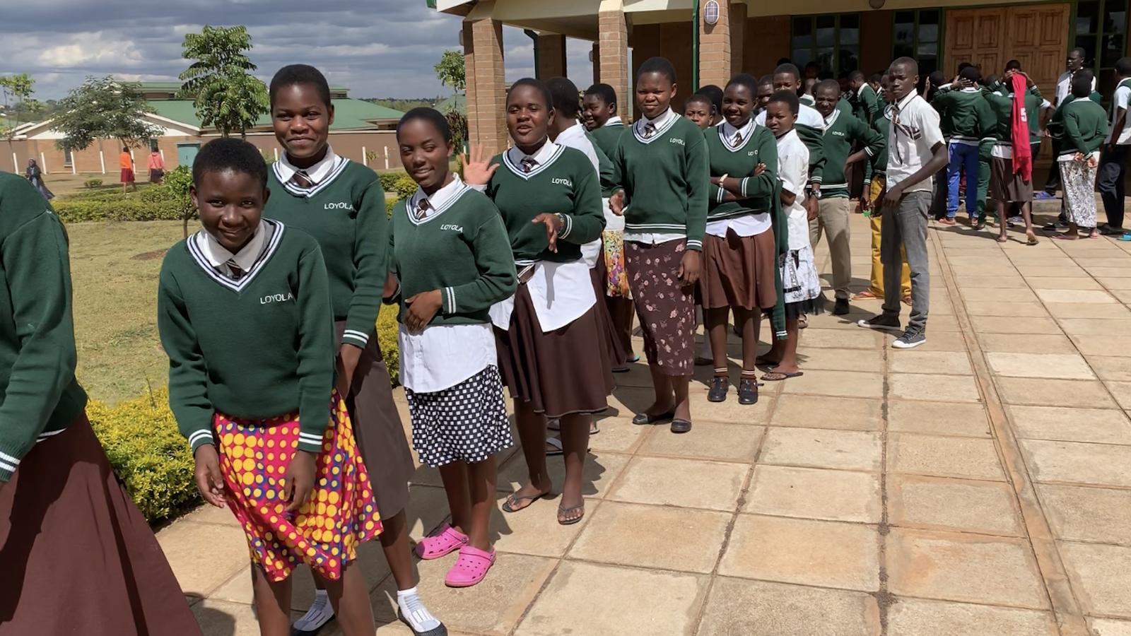 Children line up in Malawi