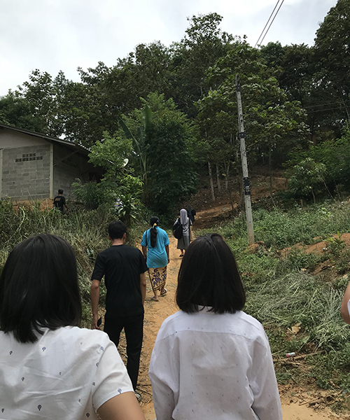 Xavier Learning Community students walking in a local village