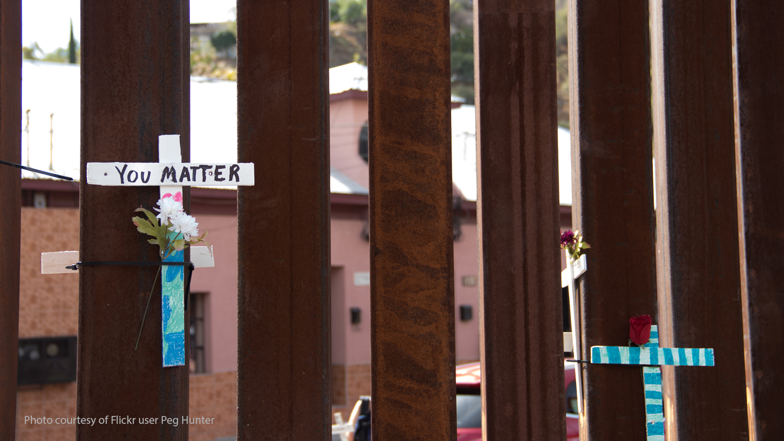 "Cross with ""You Matter"" written on it on the U.S. border wall."