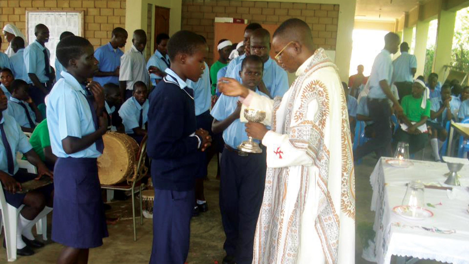 Priest Celebrating Mass with Students at OCER Campion Jesuit College in Gulu, Uganda