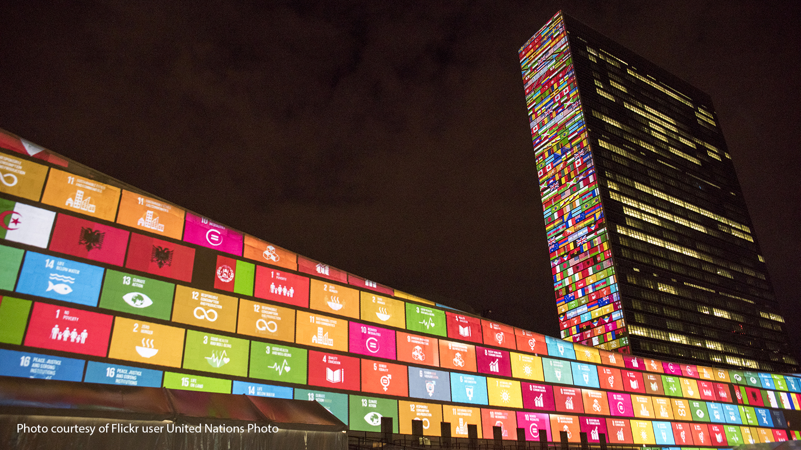 United Nations headquarters in New York lit up by pictures of the sustainable development goals.