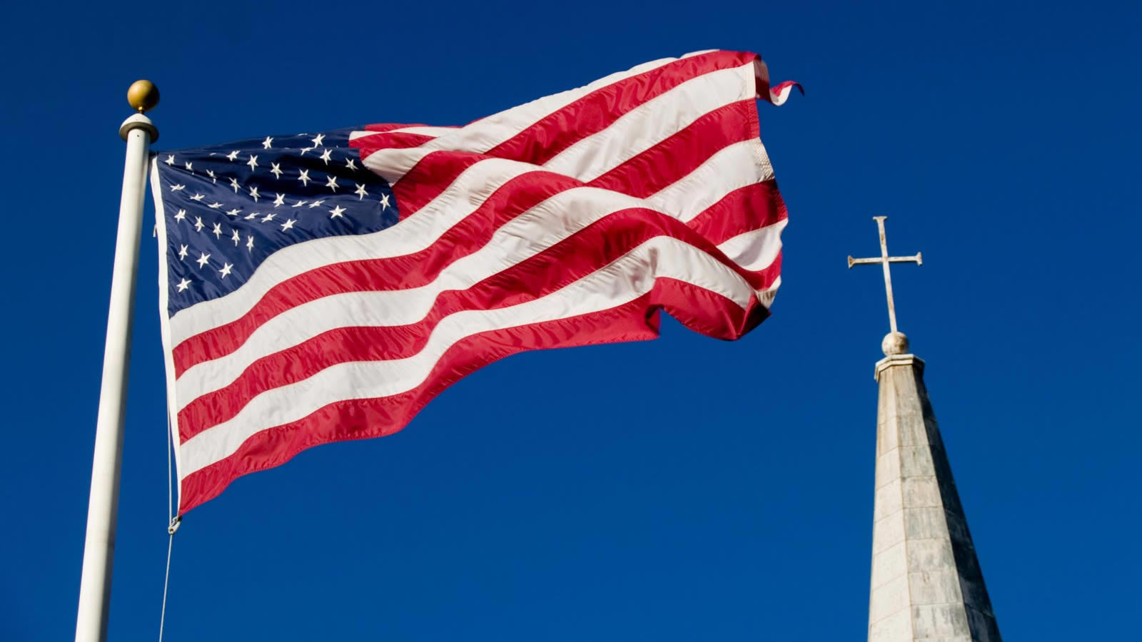 United States Flag and Church Steeple with Cross