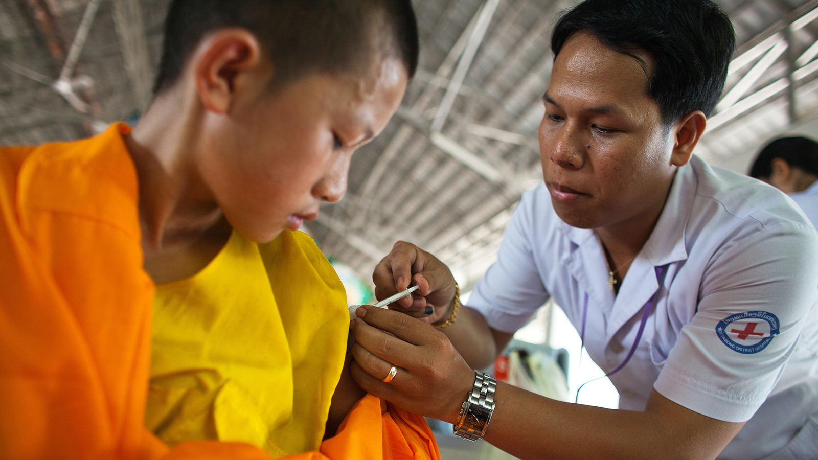 Buddhist child receiving a vaccination.