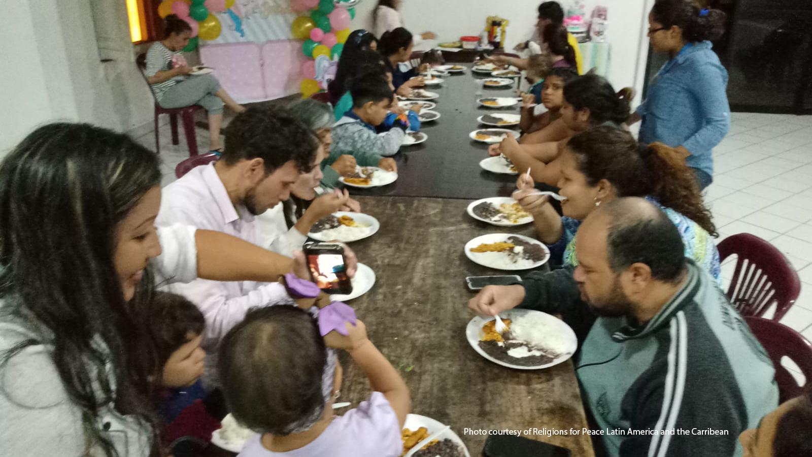 Venezuelans sharing a community meal.