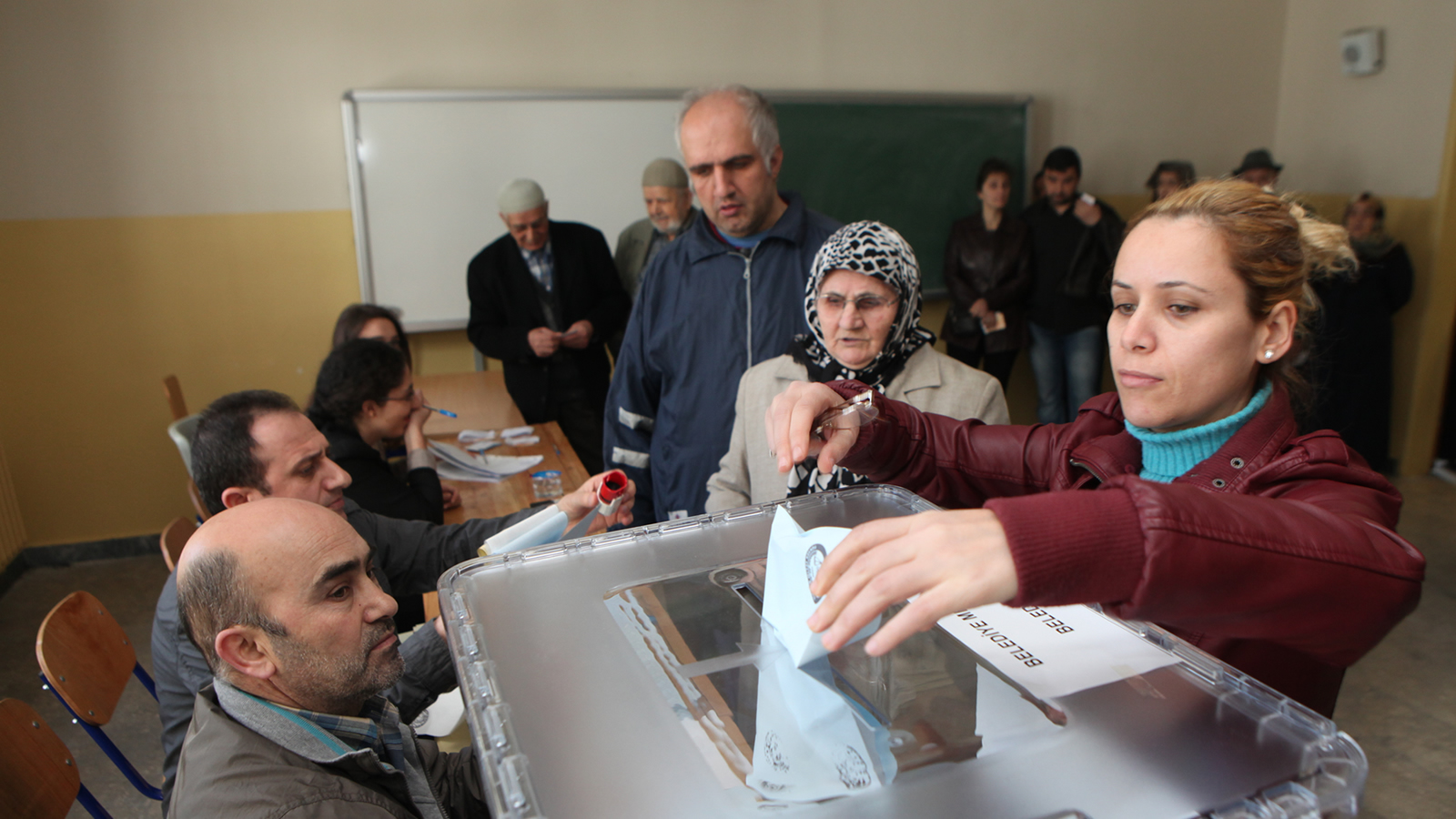 Woman Putting Vote in Voting Box in Turkey