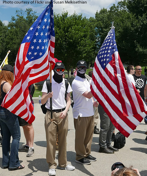 Alt-Right Protesters in Masks Holding American Flags