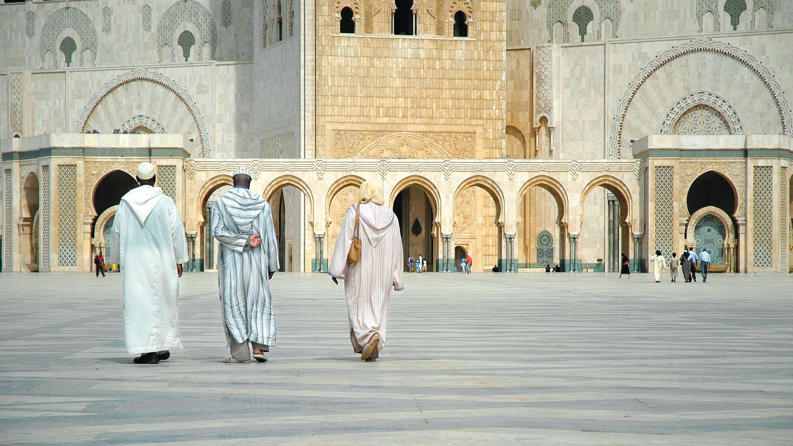 White/Tan Mosque Courtyard with People Walking