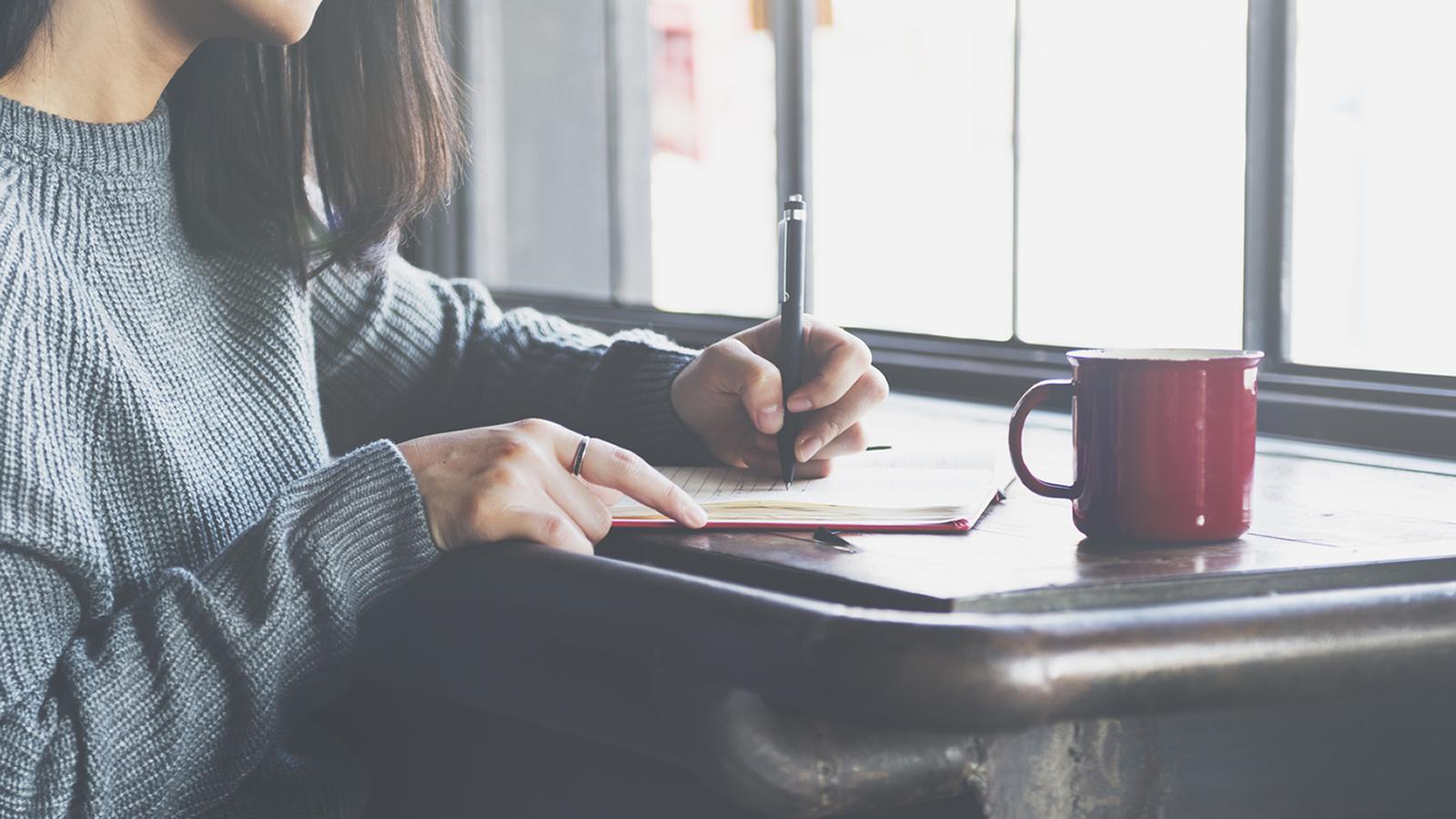 Woman writing.