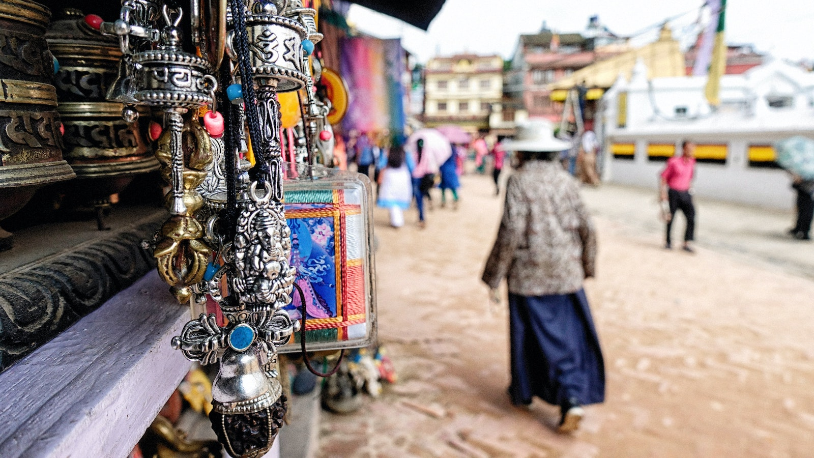 Woman walks through an outdoor market in Kathmandu, Nepal
