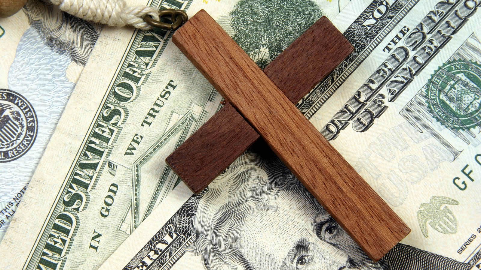 Wooden Cross Over United States Money
