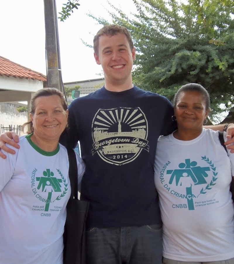 Adam Barton flanked by two volunteers from Pastoral da Criança in Brazil, 2014.