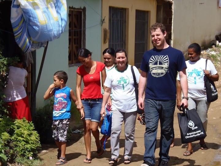 Adam Barton walks with members of Pastoral da Criança in Brazil, 2014.