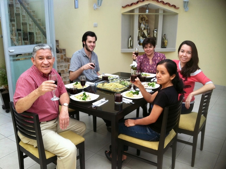 Nicholas DiRago enjoys dinner with his host family in Lima, Peru, 2013.