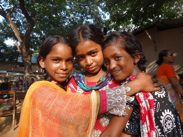 Three students pose together in Bangladesh, 2014. Photograph by Kendra Layton (C'15).