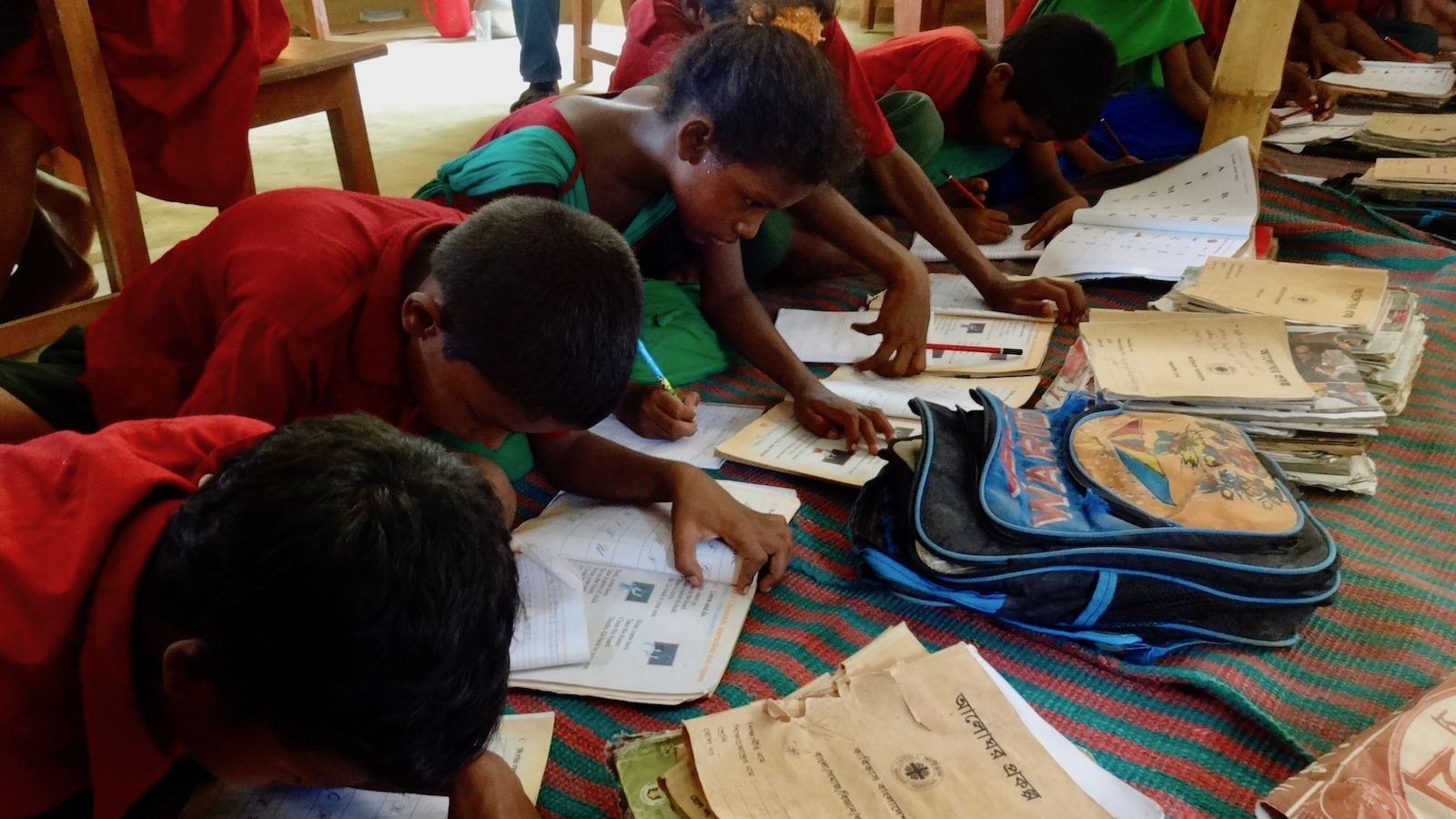 Students completing schoolwork in Bangladesh, 2014.