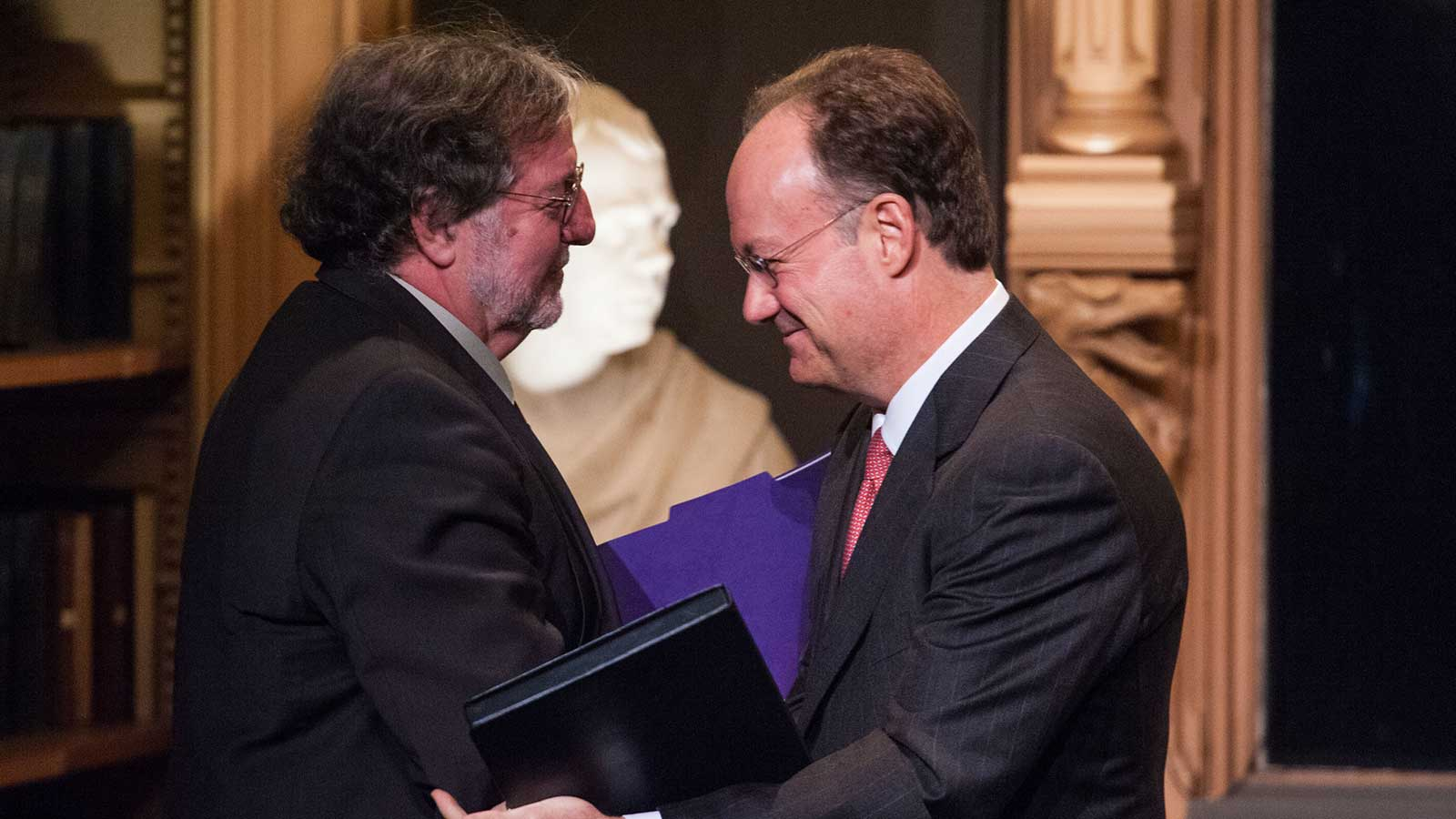 President John J. DeGioia shakes hands with José Casanova after the 2012 Berkley Center Lecture.