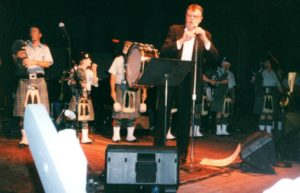 Garrison Keillor introduces the Berkshire Highlanders during the first broadcast of A Prairie Home Compabion at Tanglewood, July 2, 2000. photo: Dave Read.