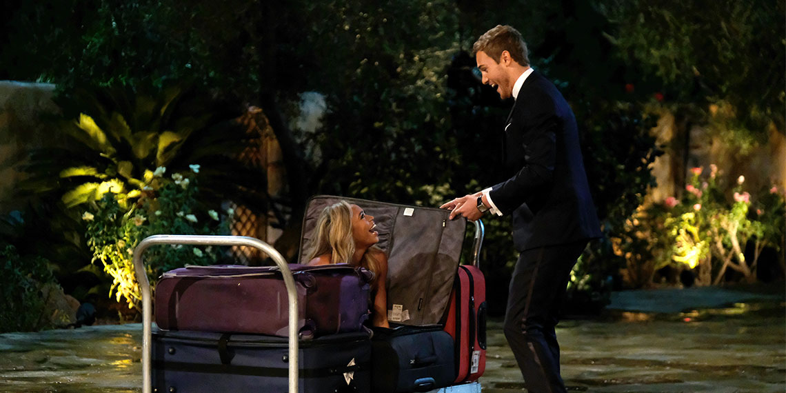 Image result for girls pops out of suitcase on bachelor