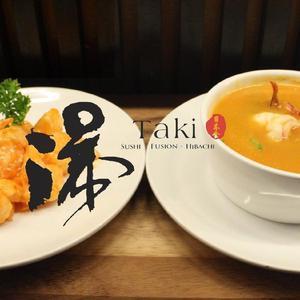 Taki Japanese Steakhouse logo