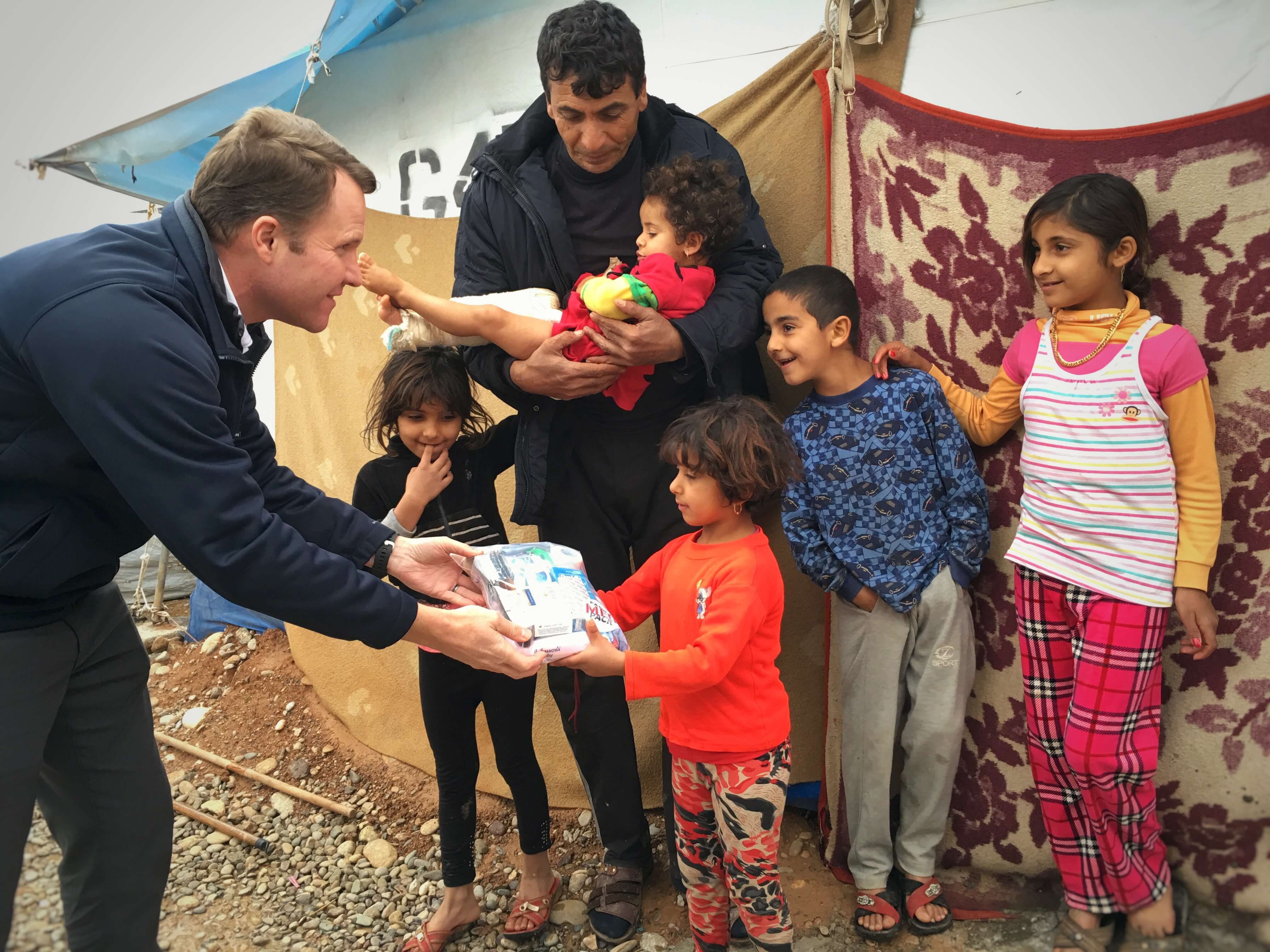 Jason Peters distributing Family Med Packs in Iraq