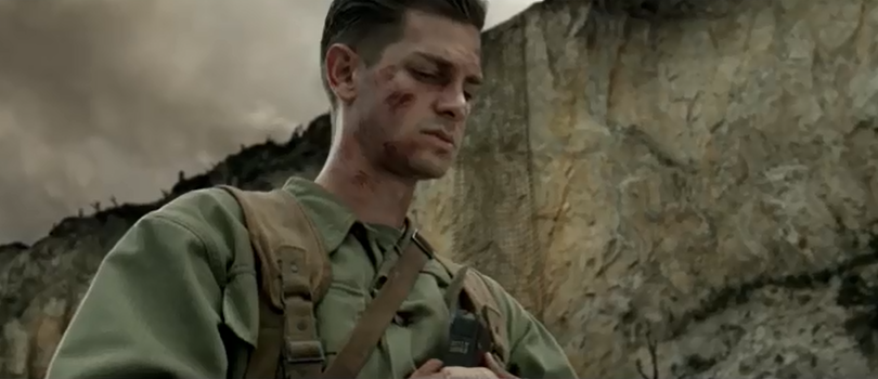 Andrew Garfield acting as Pfc. Desmond T. Doss in prayer in the movie Hacksaw Ridge