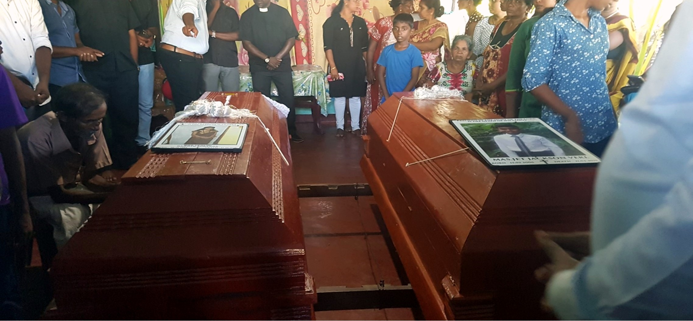 Photo of the funeral for a Sunday school teacher and 13-year-old boy killed in the Sri Lanka church suicide bombings