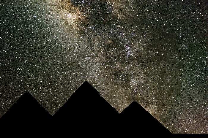 The silhouette of pyramids against the star-filled night sky to illustrate the wonder of God