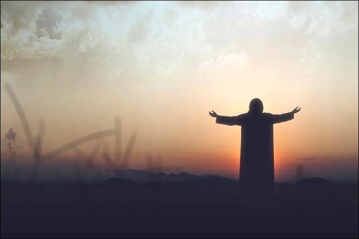 Silhouette of a man with outstretched arms illustrating Jesus