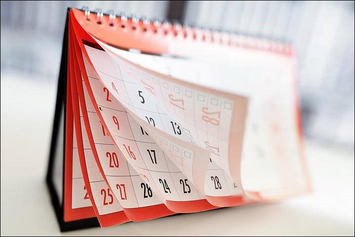 Photograph of calendar pages flipping