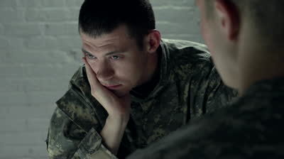 Stock-footage-sad-male-soldier-with-hand-on-face