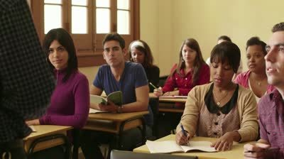 Stock-footage-people-at-school-student-raising-hand-and-asking-question-to-professor-during-class-at-university