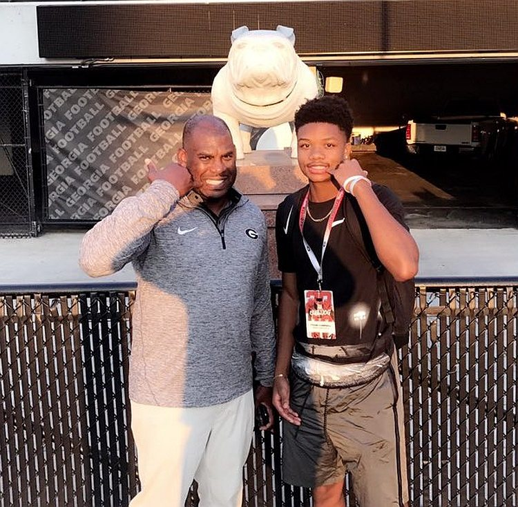 Tyson Campbell (right) with Georgia Defensive Coordinator Mel Tucker (left) (photo from Tyson Campbell / Twitter)