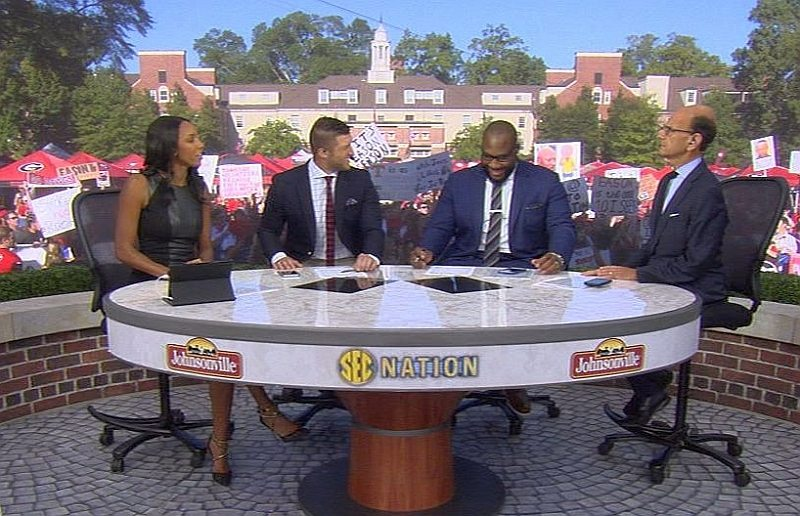 Tim Tebow, Marcus Spears and Paul Finebaum on the set of SEC Nation, Athens, GA (Photo is a screen capture of YouTube video)