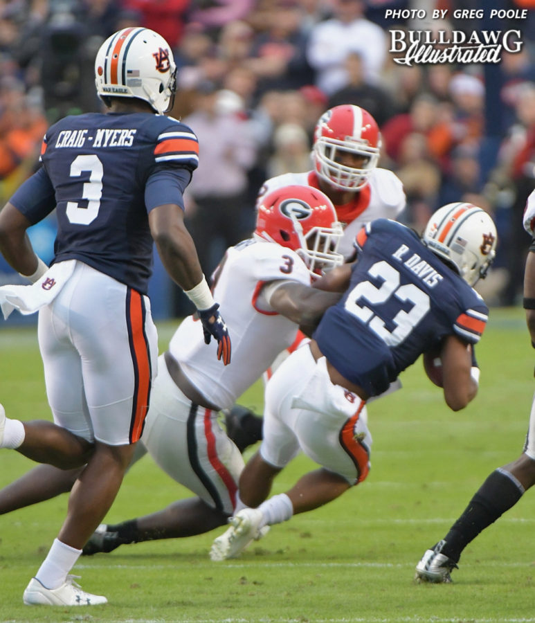 UGA's Roquan Smith (3) hits Tigers' Ryan Davis (23)  - Georgia vs. Auburn, Sat., Nov. 11, 2017 -