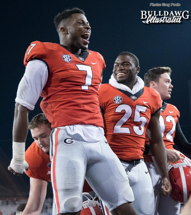 Lorenzo Carter celebrates with fans after Georgia's victory over Kentucky – Senior Day 2017