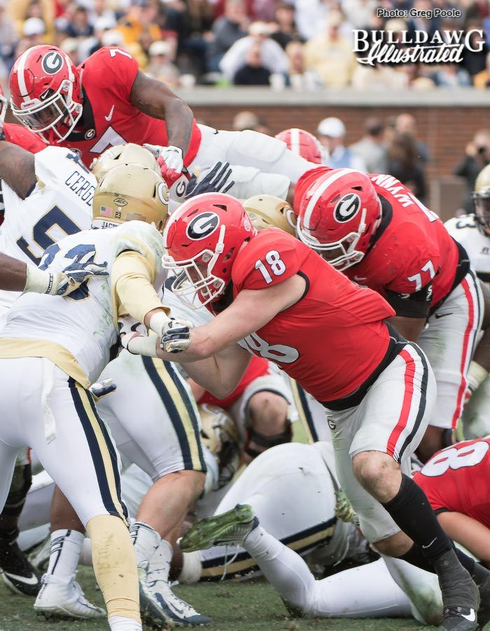 D'Andre Swift (7) goes up and over from 2-yards out to put six on the board for the Bulldogs in the third-quarter. TE Isaac Nauta (18) and OT Isaiah Wynn (77) shown blocking. - UGA vs. GT - Saturday, Nov. 25, 2017 -
