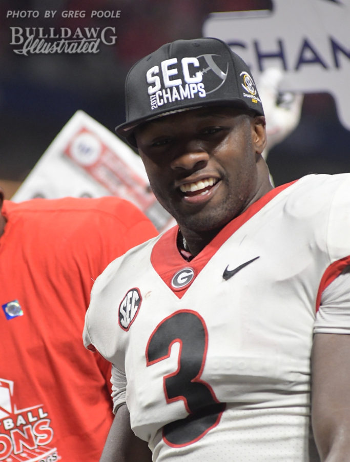 Roquan Smith got his 2017 SEC Champion's hat on and a big Bulldog smile on the podium after Georgia defeats Auburn 28-7 on Saturday evening in the Mercedes-Benz Stadium to grab the conference crown.