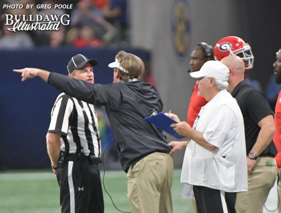 Kirby Smart makes his case to an official after Georgia is flagged for a penalty during the SEC Championship game on Saturday, Dec. 2, 2017.