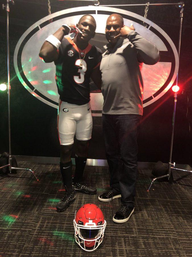 2018 defensive back Divaad Wilson with UGA defensive coordinator Mel Tucker  (Photo from Divaad Wilson / Twitter)