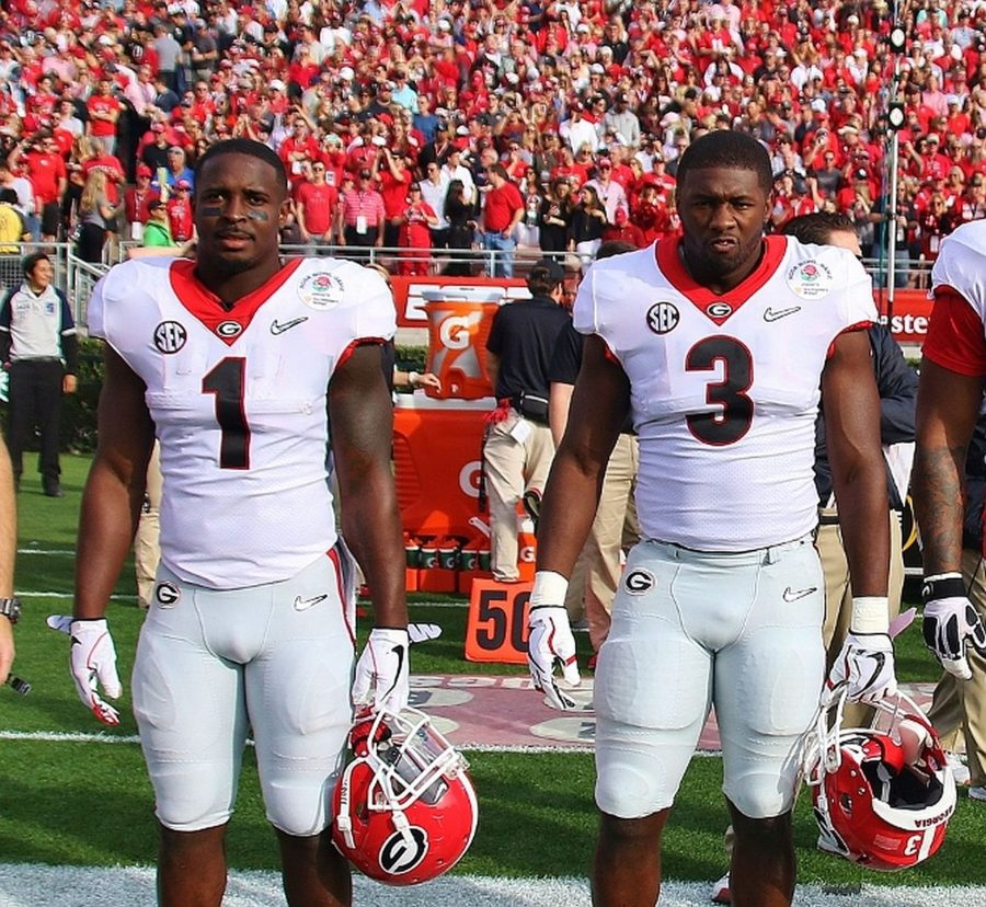 Two of Georgia's four captains for the 2018 Rose Bowl game Sony Michel (1) and Roquan Smith (3) -  (Photo by Rob Saye)