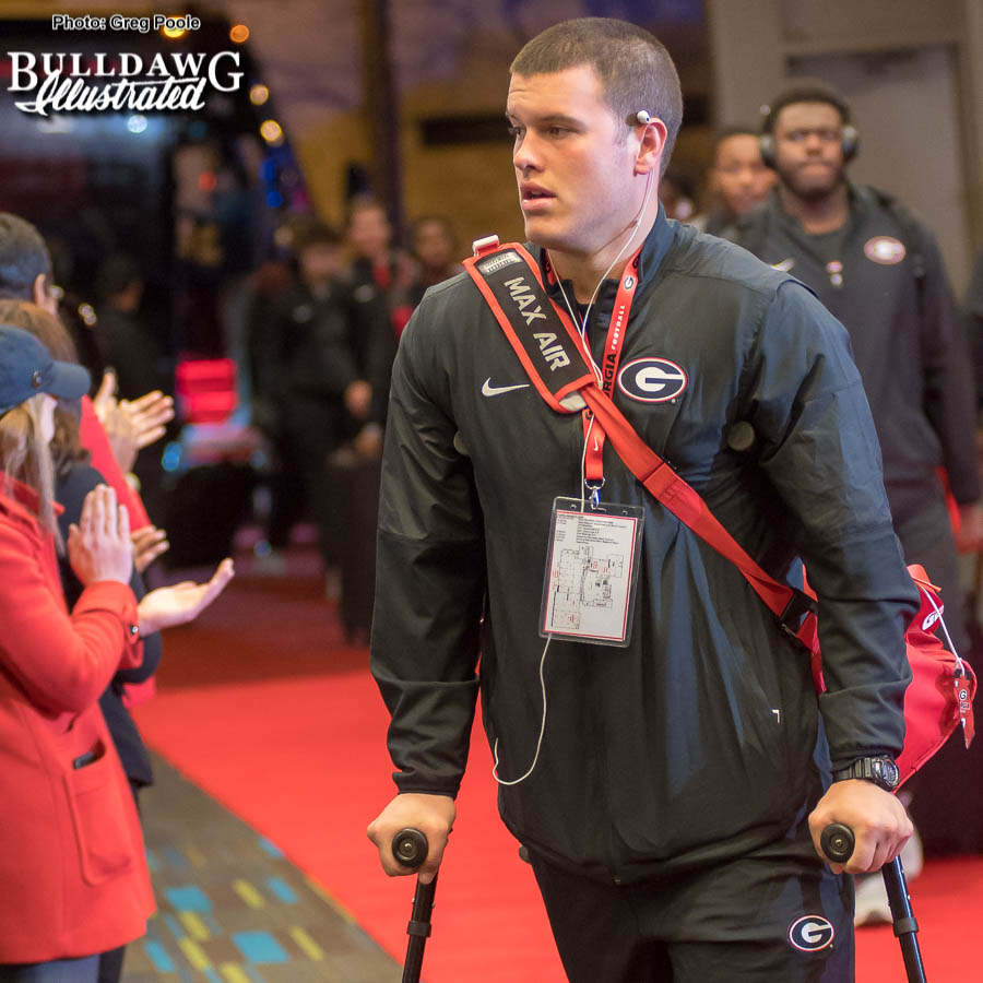 Tight end Charlie Woerner still on crutches as the Bulldogs arrive at the team hotel on Friday for the National Championship game on Monday at the Mercedes-Benz Stadium in Atlanta.