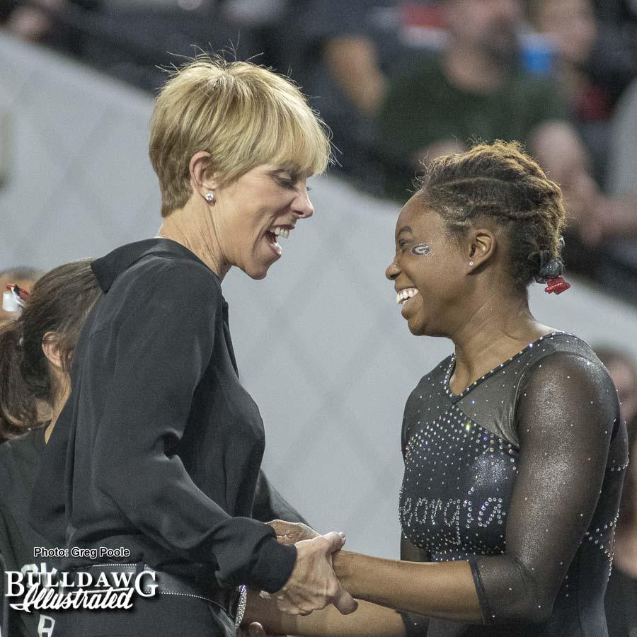 Suzanne Yoculan Leebern congratulates Jasmine Arnold after floor routine – Georgia vs. Oklahoma – January 15, 2018